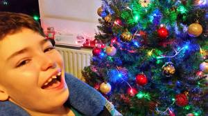 brendan smiles at christmas tree