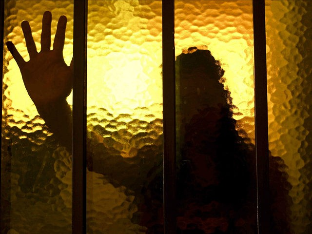 silhouette-girl-behind-bars-window-human-trafficking-ap-640x480